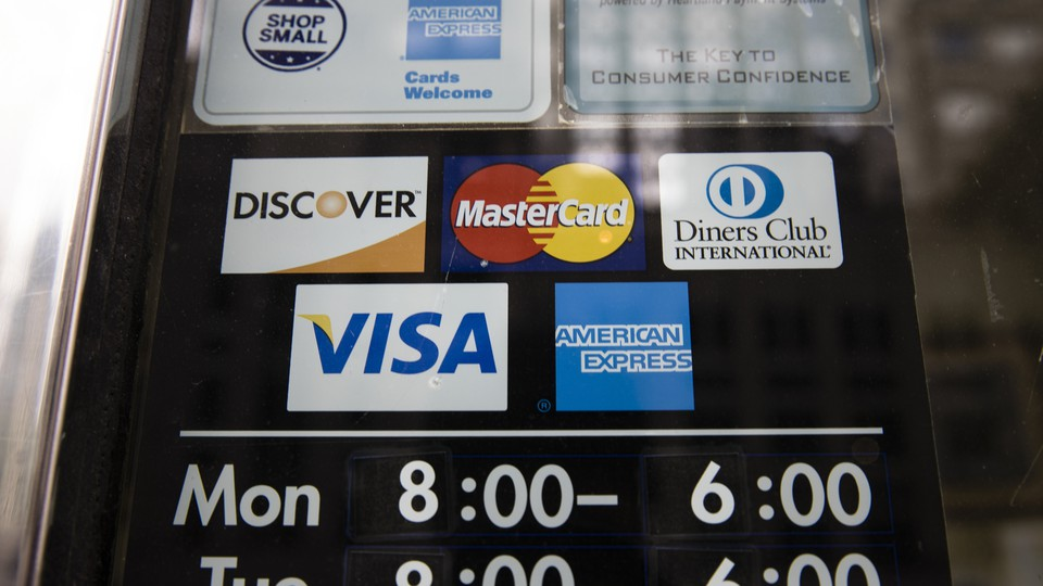 A sign with the logos of various credit-card companies