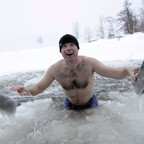 Kai Kubierske from Bonn, Germany, smiles as he emerges from an ice-filled pond in Finland.