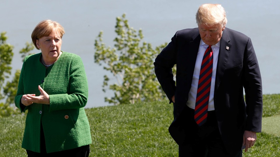 GermanChancellor Angela Merkel talks with President Trump atthe G-7 summit in Charlevoix, Quebec, Canada onJune 8, 2018.