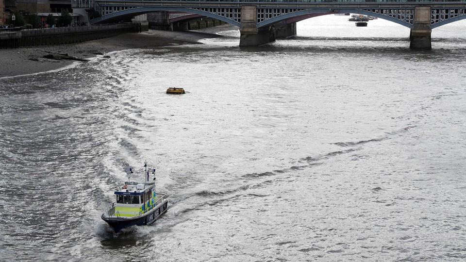 A police boat drivesalong the River Thames towards the London Bridge on June 6, 2017.