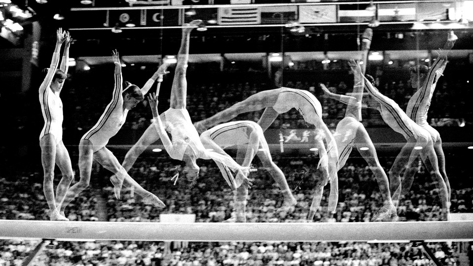A series of freeze-frames of a gymnast performing a flip