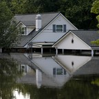 A house partly submerged by flood waters from Tropical Storm Harvey in Rose City, Texas