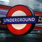 A photo shows a London Underground sign.