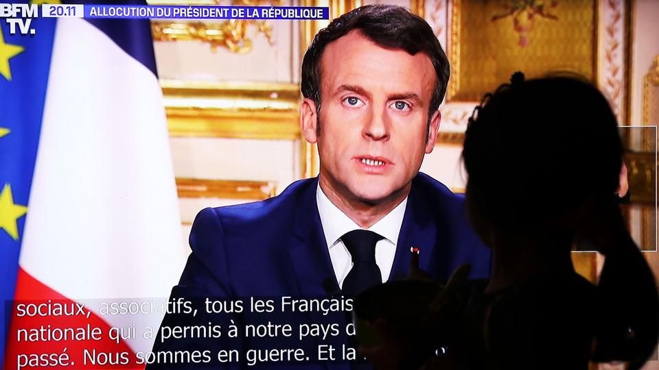 French President Emmanuel Macron delivers a televised address.