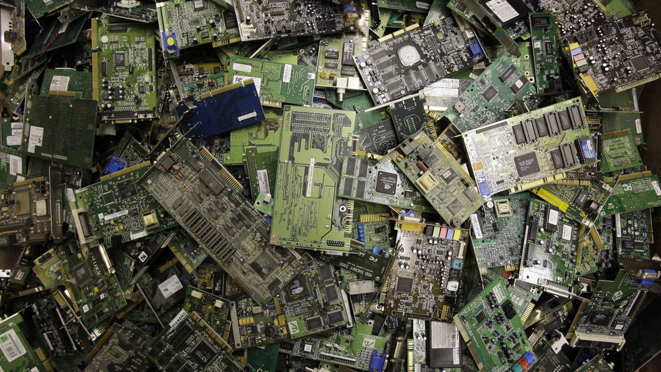 Electronic circuit boards are strewn about.