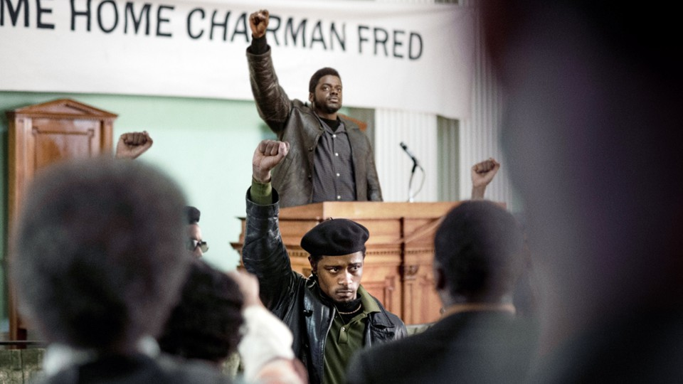 Daniel Kaluuya as Fred Hampton and Lakeith Stanfield as William O'Neal, with their fists raised