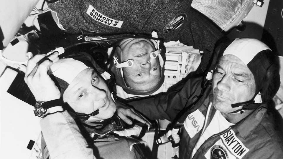 NASA astronauts and a Russian cosmonaut look cozy during a joint Russian-American space mission in 1975.