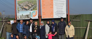 Members of the Düzce Solidarity Housing Cooperative at the project site, including Sami Kılıç (center, with dog) and Safiye Alkaya (second row, in gray cardigan)