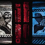 A stained glass artwork depicting two owls and geometric patterns