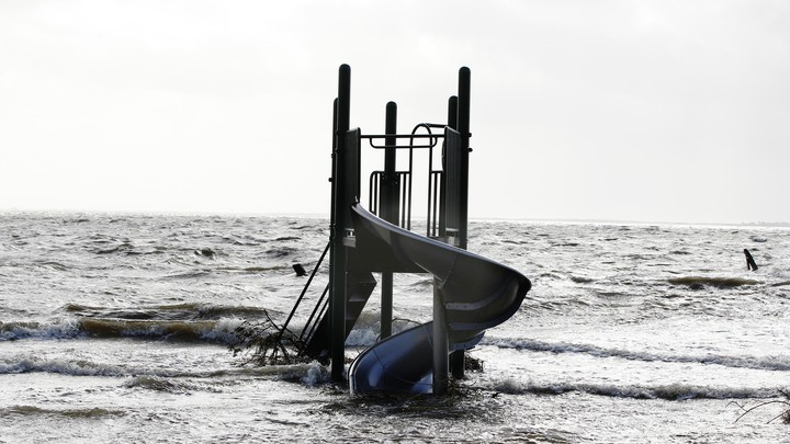 A playground slide stands surrounded by the storm surge of Hurricane Sandy, in Bellport, New York, in October 2012.