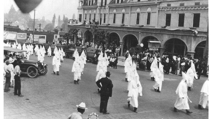 A Ku Klux Klan March in Ashland, Oregon (Date unknown; estimated to be from the 1920s)