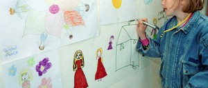 A child draws as part of a therapy program designed to help kids deal with trauma.