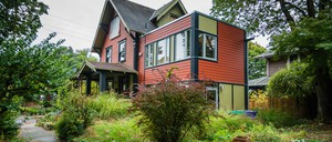 A small accessory dwelling unit—known as an ADU—is attached to an older single-family home in a Portland, Oregon, neighborhood.