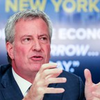 Portrait of Mayor Bill de Blasio of New York City speaking at a news conference.