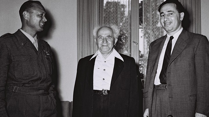David Ben-Gurion, center, thenIsrael's defense minister, stands with Moshe Dayan, the military's Chief of Staff, left, Shimon Peres, the director general of the Ministry of Defensein Tel Aviv on February 2, 1955.