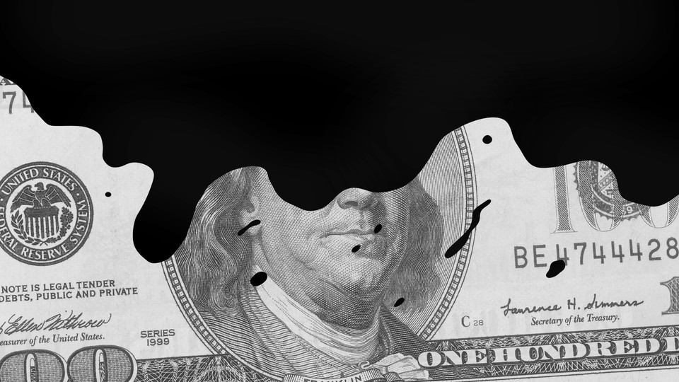 a $100 dollar bill doused in black oil