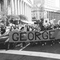 photo of protesters with 'George Floyd' banner
