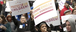Demonstrators react during a Chicago Teachers Union protest in Chicago, March 27, 2013. Thousands of demonstrators rallied in downtown Chicago on Wednesday to protest the city's plan to close 54 public schools, primarily in Hispanic and African-American neighborhoods.