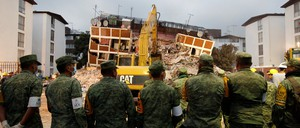 Soldiers outside a collapsed building in Mexico City on September 20, 2017.