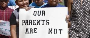 Children holding signs.
