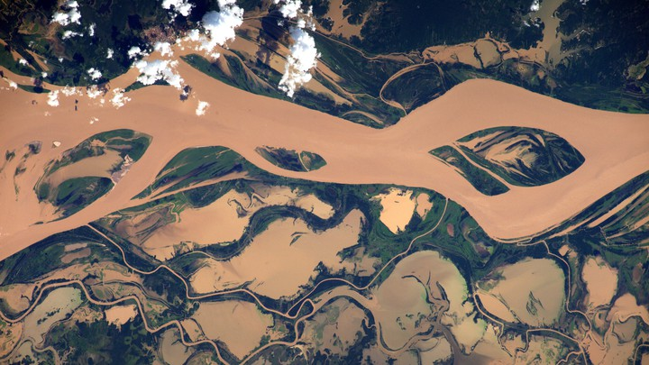 An aerial view of a muddy river.