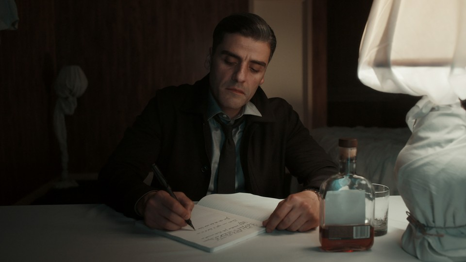 """Oscar Isaac writes in a diary in """"The Card Counter."""""""