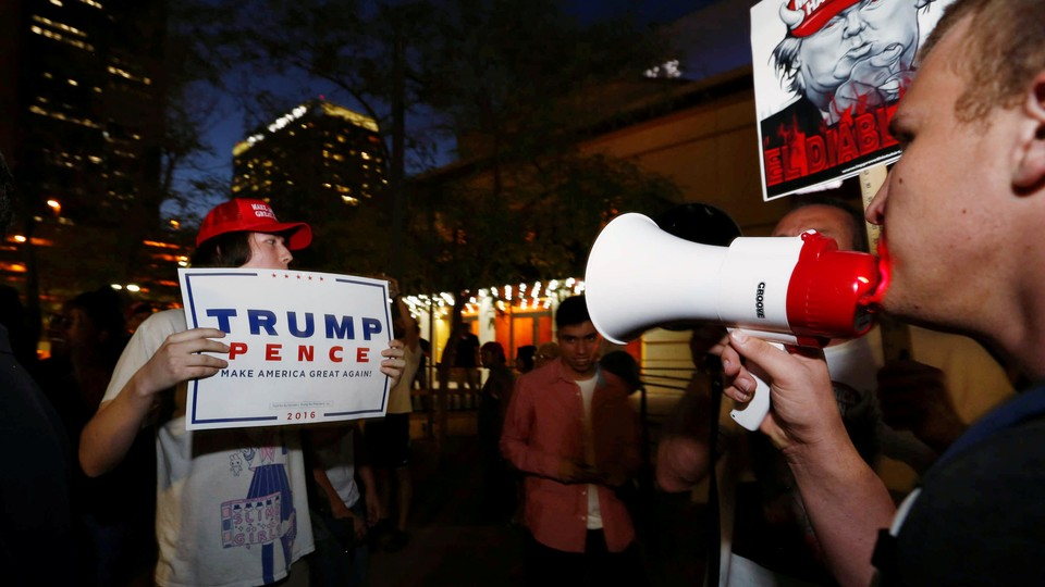 Pro- and anti-Trump protestors square off outside a rally in Arizona in August.