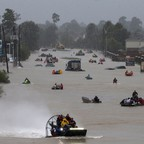 Residents use boats to evacuate flood waters from Tropical Storm Harvey in Houston, August 28, 2017.