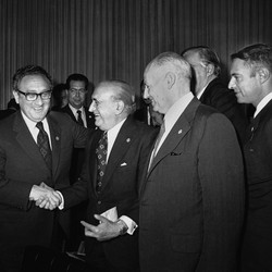 U.S. Secretary of State Henry Kissinger greets Argentina's Foreign Minister, Alberto J. Vignes, as Ismael Huerta Diaz, right, foreign ministers of Chile, looks on during break in Latin Foreign Ministers Conference in Mexico City, Feb. 22, 1974.