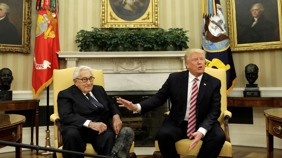 Donald Trump and Henry Kissinger meet in the Oval Office on May 10.