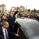 French presidential election candidate Emmanuel Macron greets supporters as he leaves a polling station on May 7, 2017.