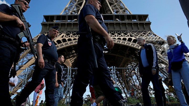 French policemen on patrol by the Eiffel Tower in Paris.