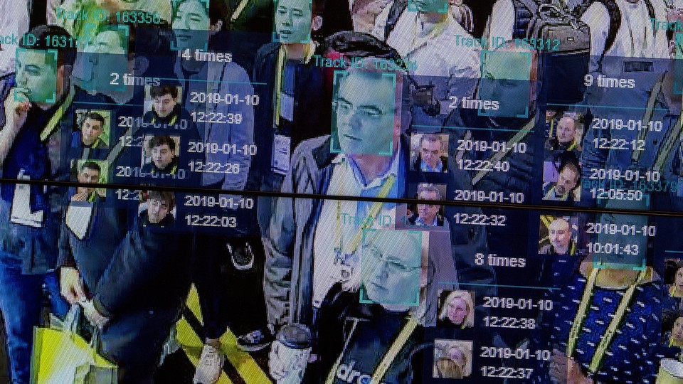 A live demonstration uses AI to scan and recognize faces in a crowd.