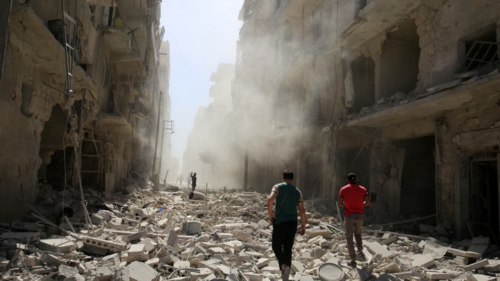 Men inspect the damage after an airstrike on the rebel held al-Qaterji neighbourhood of Aleppo, Syria September 25, 2016.