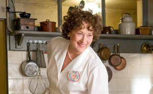 Meryl Streep in a white chef's outfit playing Julia Child