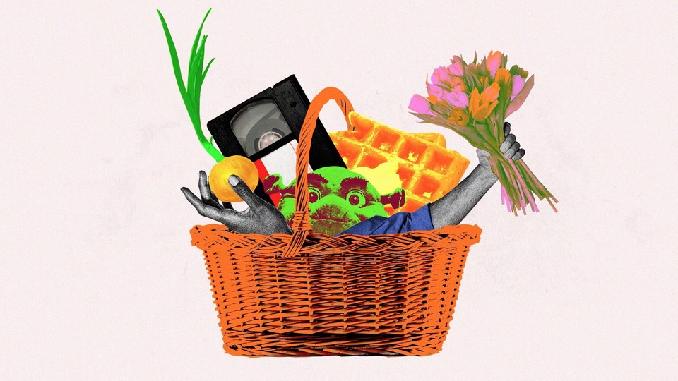 A basket that includes Shrek, an onion, a VHS tape, flowers and a waffle.