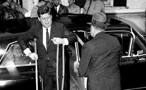 Kennedy's chronically bad back was only one of his enduring ailments. Here, he is heading to the presidential yacht in June 1961 to host the Japanese prime minister.