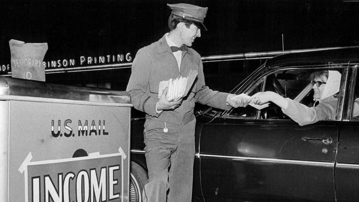 A postman collecting tax returns.