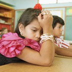 Fourth-graders Rocio Belmontes and Juan Patino attend class in Naranja, Florida.