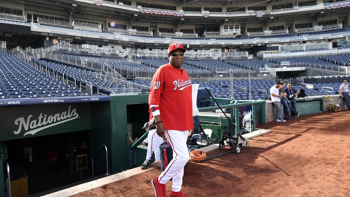 Washington Nationals' Dusty Baker walks on the field during practice at Nationals Park