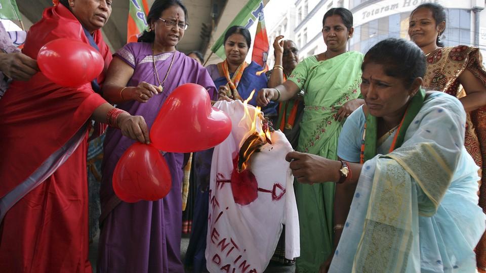Activists from the Bharatiya Janata Party burn an effigy representing Valentine's Day.