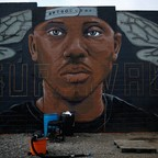 photo: A mural of local anti-violence activist Kwame Rose on a wall in West Baltimore.