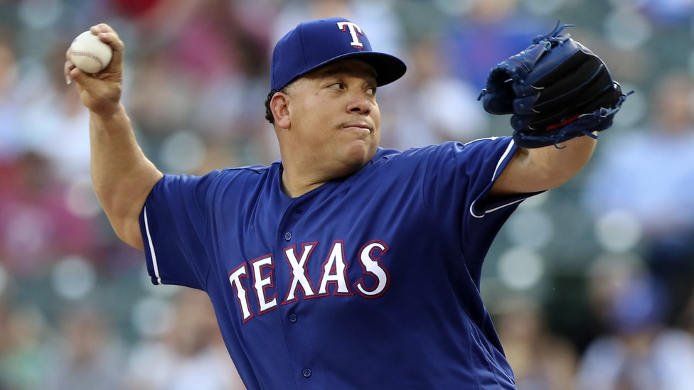 The Texas Rangers starting pitcher Bartolo Colon (40) throws during the first inning against the New York Yankees at Globe Life Park in Arlington on May 22