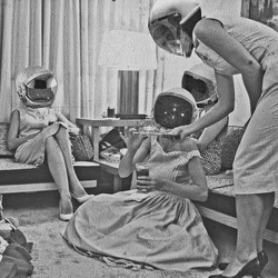 A black-and-white photo of 1950s women in astronaut helmets
