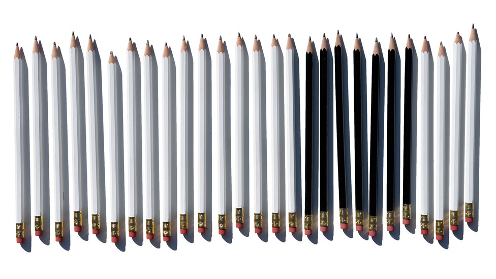 illustration of a row of white pencils with 7 black pencils in the middle