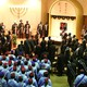 Hebrew Israelite congregants sing during Sabbath worship services, with elders and community leaders nearest the pulpit.