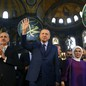 Erdogan, centre, accompanied by his wife Emine, right, waves to supporters as he walks in the Byzantine-era Hagia Sophia, an UNESCO world heritage site and one of Istanbul's main tourist attractions, in the historic Sultanahmet district of Istanbul. The 6th-century building is now at the center of a heated debate between conservative groups who want it to be reconverted into a mosque and those who believe the World Heritage site should remain a museum.