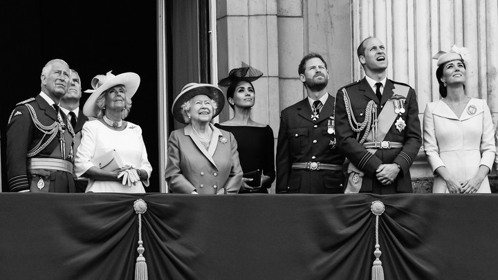 Prince Charles, the Prince of Wales; Camilla, the Duchess of Cornwall; Prince Andrew, the Duke of York; Queen Elizabeth ll; Meghan, the Duchess of Sussex; Prince Harry, the Duke of Sussex; Prince William, the Duke of Cambridge; and Catherine, the Duchess of Cambridge, stand on the balcony of Buckingham Palace.