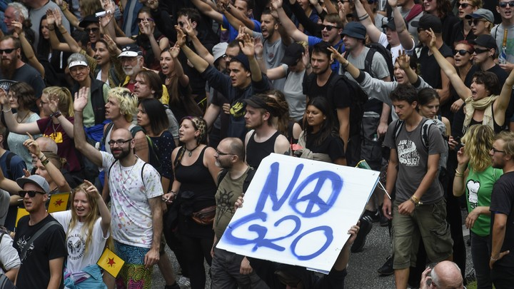 Protesters hold a placard that reads 'No G20' during demonstrations at the G20 summit in Hamburg, Germany.