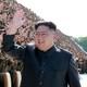 Kim Jong Un waves and smiles